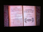 Image of Mrs Beeton's book with graphics in the background similiar to my graphics